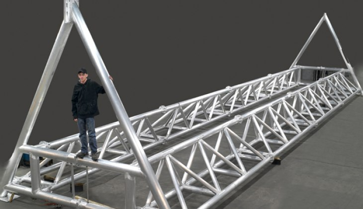 Tubular aluminum bridge structure for the University of Iowa's Wave Basin Laboratory that spans a 150 foot wide pool. Laser cut tubes and welded to close tolerance.