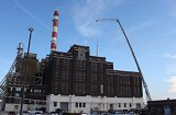 Crane lift during the installation of a chimney system at a utility company made at Schebler Specialty Fabrication