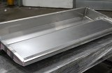 Stainless steel delicatessen case liner. Complete assembly including cutting, forming, welding, insulation and assembly.