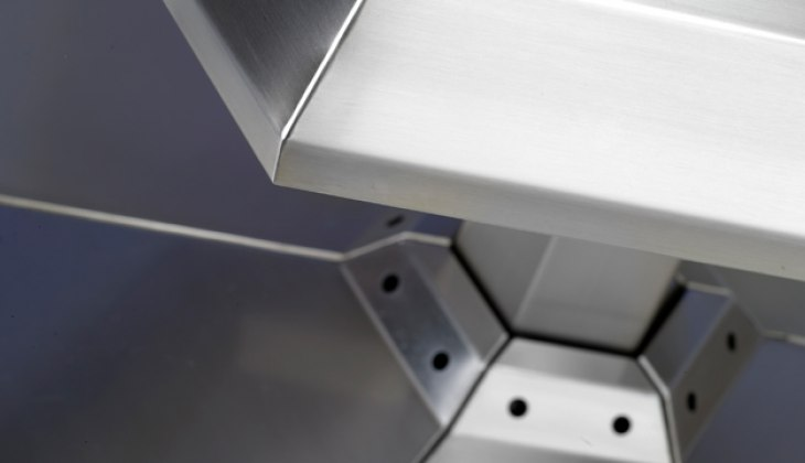 Custom stainless steel food grade display rack with cosmetically blended corner welds. Complete fabrication – laser cutting, forming, welding, surface finishing and weld blending.