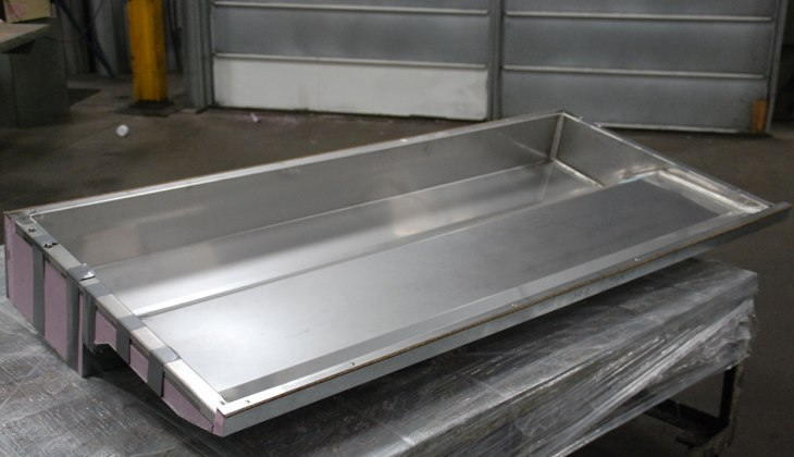Stainless steel delicatessen case liner. Complete assembly including cutting, forming, welding, insulation and assembly made at Schebler Specialty Fabrication