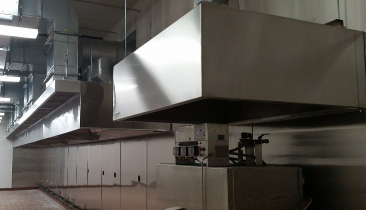 45 foot custom stainless steel industrial kitchen and dishwasher hoods with Schebler Chimney Systems FyreGuard™ grease duct and custom make-up air ductwork. After fabricating the components, they were expertly install made at Schebler Specialty Fabrication