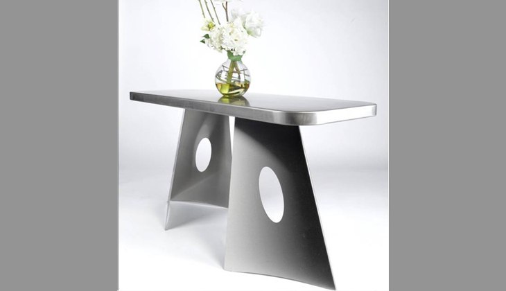 Custom stainless steel table. Complete fabrication – design, laser cutting, forming, welding, surface finishing and weld blending.