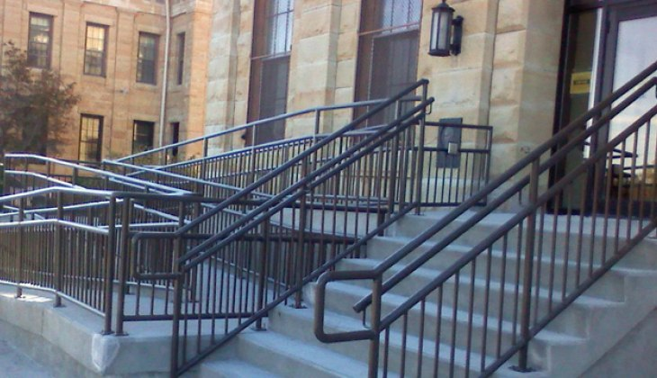 Custom tubular handrail system. Complete fabrications including design, paint and installation.