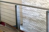 Custom railing constructed of steel with stainless wires. Complete fabrication including design, surface finishing and installation.