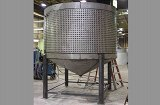 Steel tank with external cooling jackets. Complete fabrication with cutting, forming and welding.