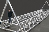 Tubular aluminum bridge structure for the University of Iowa's Wave Basin Laboratory that spans a 150 foot wide pool.  3D laser cut tubes and welded to close tolerance. [As Fabricated]