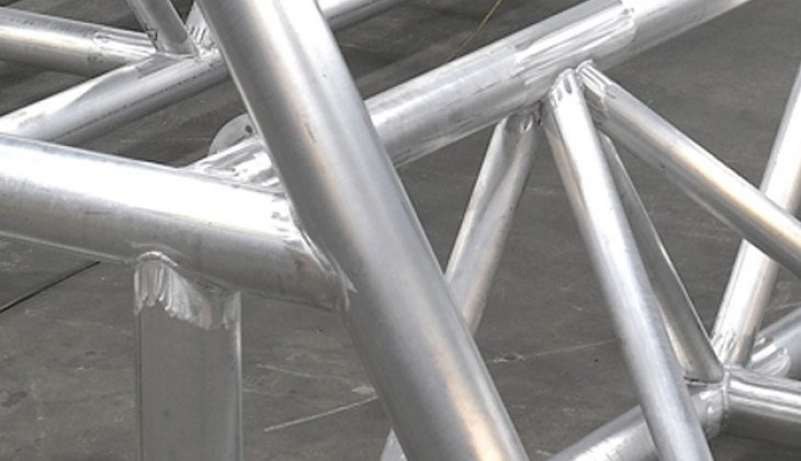 Tubular aluminum bridge structure for the University of Iowa's Wave Basin Laboratory that spans a 150 foot wide pool. Laser cut tubes and welded to close tolerance. [Close Up]