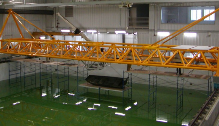 Tubular aluminum bridge structure for the University of Iowa's Wave Basin Laboratory that spans a 150 foot wide pool. Laser cut tubes and welded to close tolerance. [Painted & Installed]