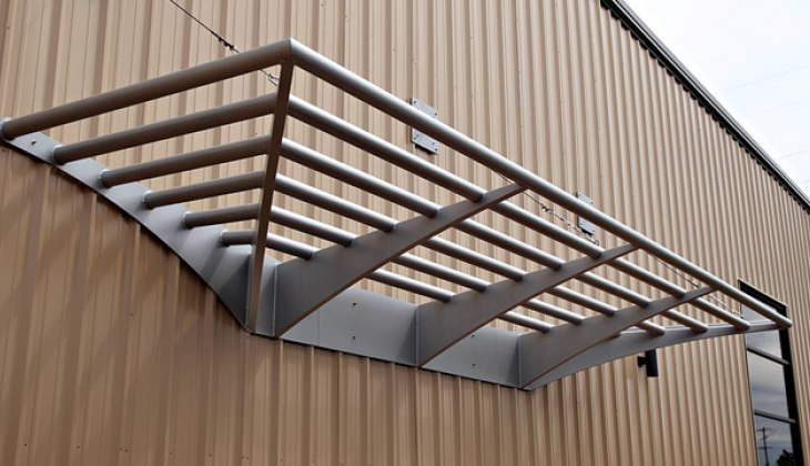 Custom tubular building canopy. Complete fabrication – design, laser cutting, forming, welding and painting.