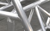 Tubular aluminum bridge structure for the University of Iowa's Wave Basin Laboratory that spans a 150 foot wide pool.  Laser cut tubes and welded to close tolerance. [Close Up] thumbnail